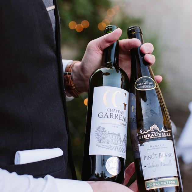 Wine bottles being served by a waiter at The Royal Crescent Hotel.