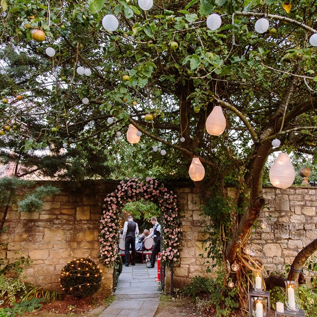 Lanterns hanging from the trees in our exclusive garden event venue in Bath.