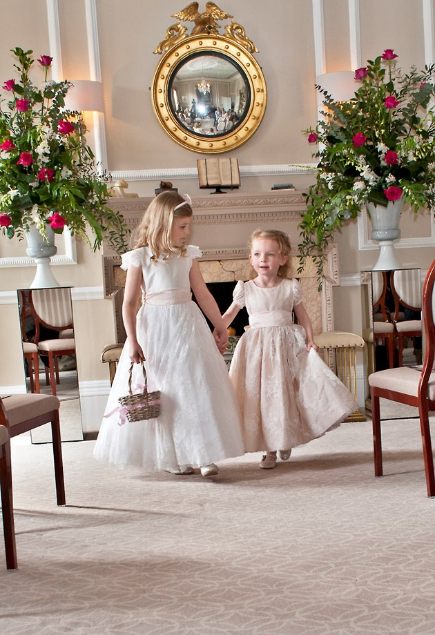 Flower girls walking down the aisle at The Royal Crescent Hotel's Wedding Venue in Bath.
