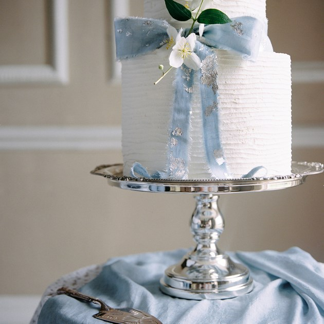 Beautiful wedding cake on a silver platter.